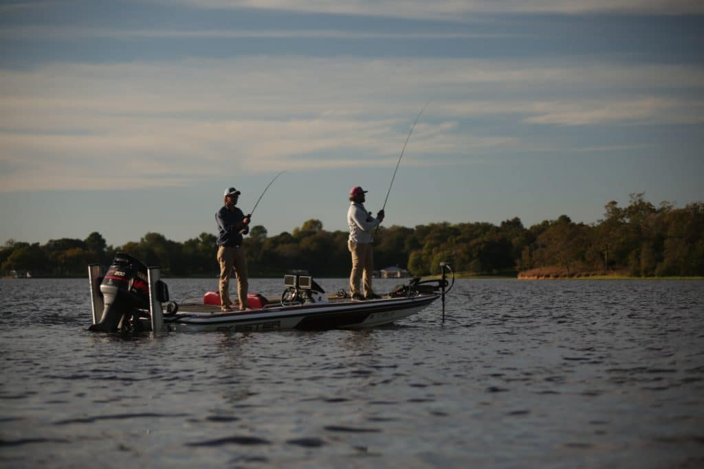 two men fishing on a bass boat
